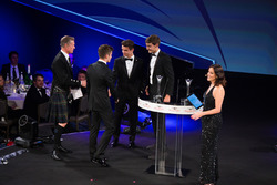 Charles Leclerc, Lando Norris and George Russell on stage