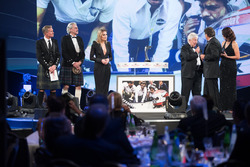 Nelson Piquet collects his Gregor Grant Award on stage with Gordon Murray and Herbie Blash
