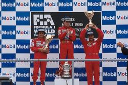 Podium: race winner Ayrton Senna, second place Alain Prost, third place Nigel Mansell
