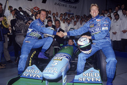 Michael Schumacher,Benetton and J.J. Lehto with Richard Grundy, Flavio Briatore, Jos Verstappen behind