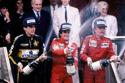 Podium: race winner Alain Prost, McLaren, second place Keke Rosberg, McLaren, third place Ayrton Senna, Lotus