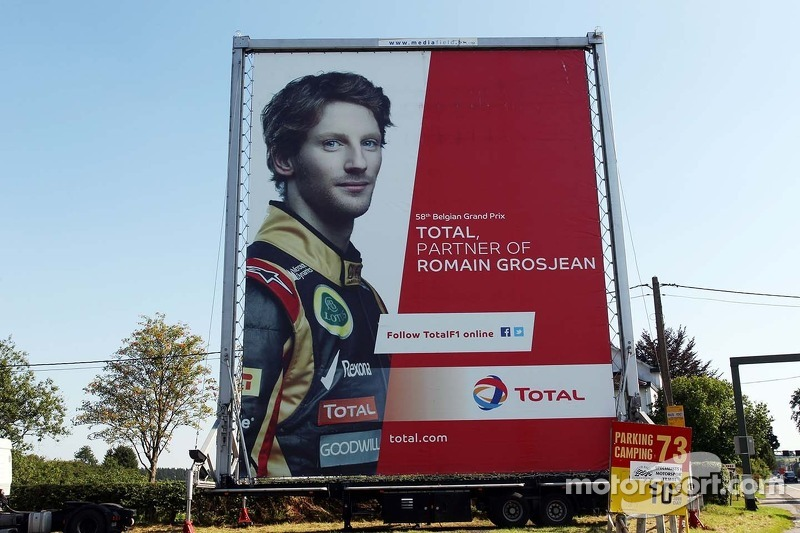 Total advertising hoarding with Romain Grosjean, Lotus F1 Team.
