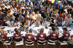 The Qatar M-Sport World Rally Team attend the official autograph signing session before the start of the 2013 Rally Australia
