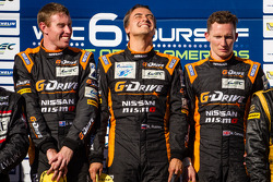 LMP2 podium: class winners John Martin, Roman Rusinov, Mike Conway