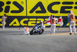 Corner workers celebrate end of the race