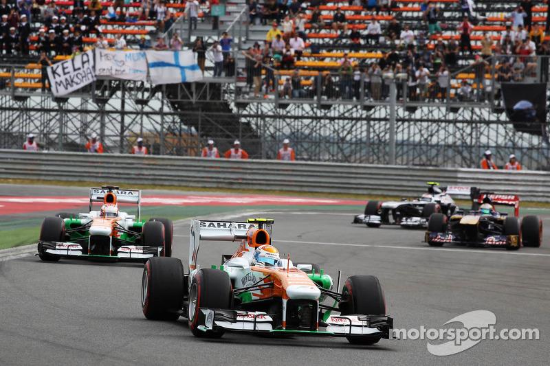 Adrian Sutil, Sahara Force India VJM06 en teamgenoot Paul di Resta, Sahara Force India VJM06