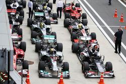 Lewis Hamilton, Mercedes AMG F1 W04 and Nico Hulkenberg, Sauber C32 head the field in parc ferme