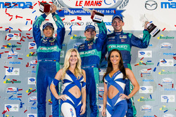 GT podium: class winners Bryan Sellers, Wolf Henzler, Nick Tandy with the charming Falken Tire girls