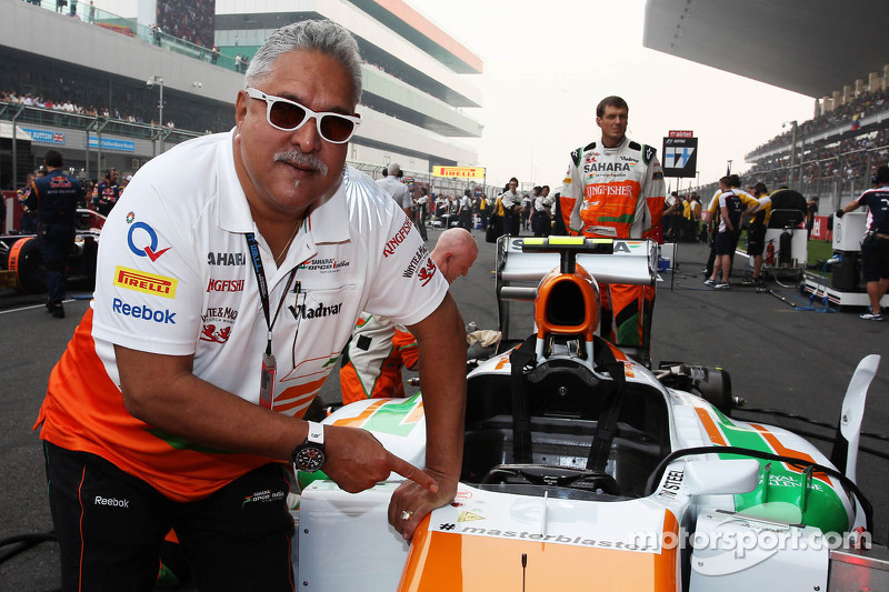 Dr. Vijay Mallya, Sahara Force India F1 Team Owner on the grid with the Sahara Force India VJM06 car
