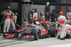 Jenson Button, McLaren MP4-28 makes a pit stop