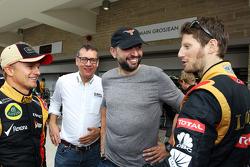 (L to R): Heikki Kovalainen, Lotus F1 Team with Eric Lux, Genii Capital CEO; Gerard Lopez, Genii Capital; and Romain Grosjean, Lotus F1 Team