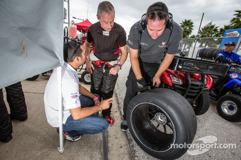 Alex Popow and Seth Neiman inspect Continental Tire