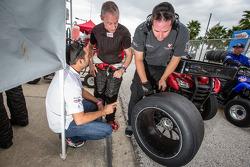 Alex Popow and Seth Neiman inspect Continental Tire