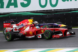Fernando Alonso, Ferrari F138 passes Sebastian Vettel, Red Bull Racing RB9