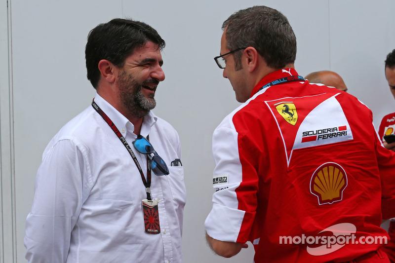 (L to R): Luis Garcia Abad, Driver Manager of Fernando Alonso, Ferrari with Stefano Domenicali, Ferrari General Director