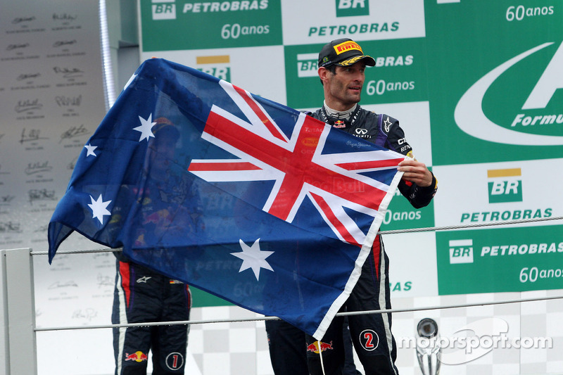 Mark Webber, Red Bull Racing celebrates his second position and his final GP on the podium