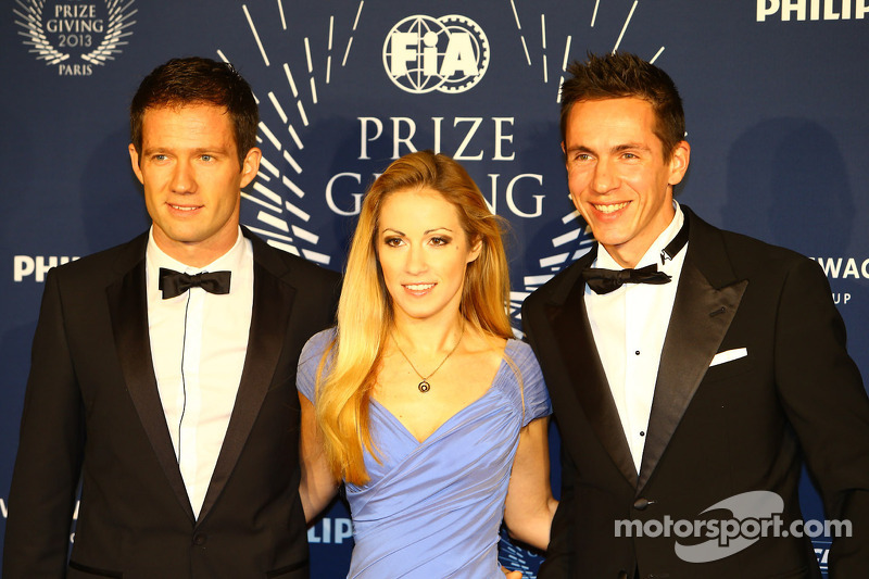 (L to R): Sébastien Ogier, WRC World Champion, with his wife and his Co-Driver Julien Ingrassia