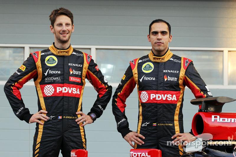 (L to R): Romain Grosjean, Lotus F1 Team and team mate Pastor Maldonado, Lotus F1 Team as the Lotus