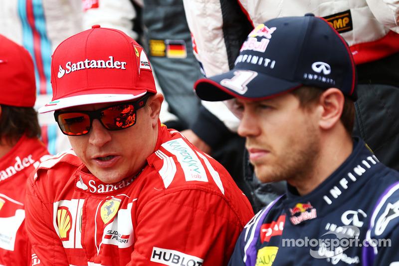 (L to R): Kimi Raikkonen, Ferrari with Sebastian Vettel, Red Bull Racing at the drivers start of season photograph