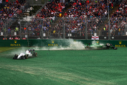 Felipe Massa, Williams FW36 and Kamui Kobayashi, Caterham CT05 crash out at the start of the race