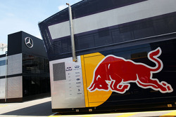 Red Bull Racing and Mercedes AMG F1 trucks in the paddock