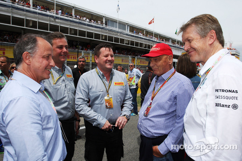 (L to R): Alberto Pirelli, Pirelli Deputy Chairman with Mario Isola, Pirelli Racing Manager, Paul Hembery, Pirelli Motorsport Director, Niki Lauda, Mercedes Non-Executive Chairman, on the grid