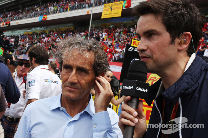 (L to R): Alain Prost, with Thomas Senecal, Canal+ F1 Chief Editor and TV Presenter on the grid
