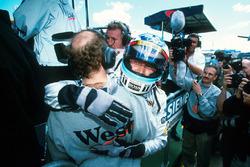 Race winner Mika Hakkinen, McLaren celebrates victory by embracing Adrian Newey, McLaren Technical Director