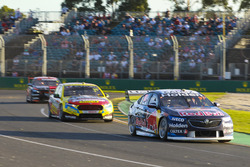 Shane van Gisbergen, Triple Eight Race Engineering Holden, leads Chaz Mostert, Tickford Racing Ford, and Scott Pye, Walkinshaw Andretti United Holden