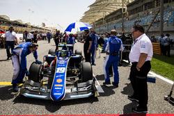 Zak Brown, McLaren, watches Lando Norris, Carlin