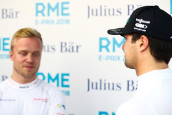 Nelson Piquet Jr., Jaguar Racing, talking to Felix Rosenqvist, Mahindra Racing, in the media pen