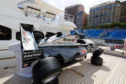 An old Mika Hakkinen McLaren is displayed on the deck of a boat in the harbour