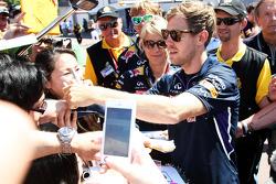Sebastian Vettel, Red Bull Racing signs autographs for the fans