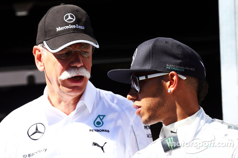 (L to R): Dr. Dieter Zetsche, Daimler AG CEO with Lewis Hamilton, Mercedes AMG F1