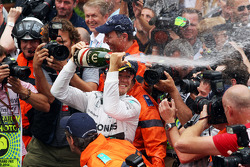 Race winner Nico Rosberg, Mercedes AMG F1 celebrates with the champagne at the podium