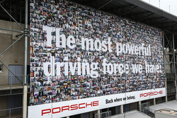 Huge advertising banner  for Porsche overlooking the paddock area