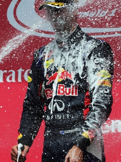 Race winner Daniel Ricciardo, Red Bull Racing celebrates with the champagne on the podium