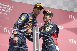 Daniel Ricciardo celebrates on the podium with team mte Sebastian Vettel