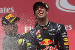 Race winner Daniel Ricciardo, Red Bull Racing celebrates on the podium with team mate Sebastian Vett
