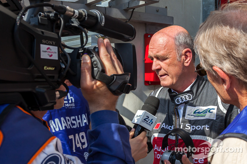 Dr. Wolfgang Ullrich addressing the media following Loic Duval's crash, reporting he was concious