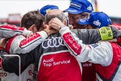 Overall race winners Benoit Tréluyer, Andre Lotterer and Marcel Fässler celebrate with Dr. Wolfgang Ullrich and Ralf Jüttner