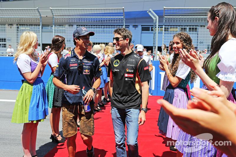 (L to R): Daniel Ricciardo, Red Bull Racing with Romain Grosjean, Lotus F1 Team on the drivers parad