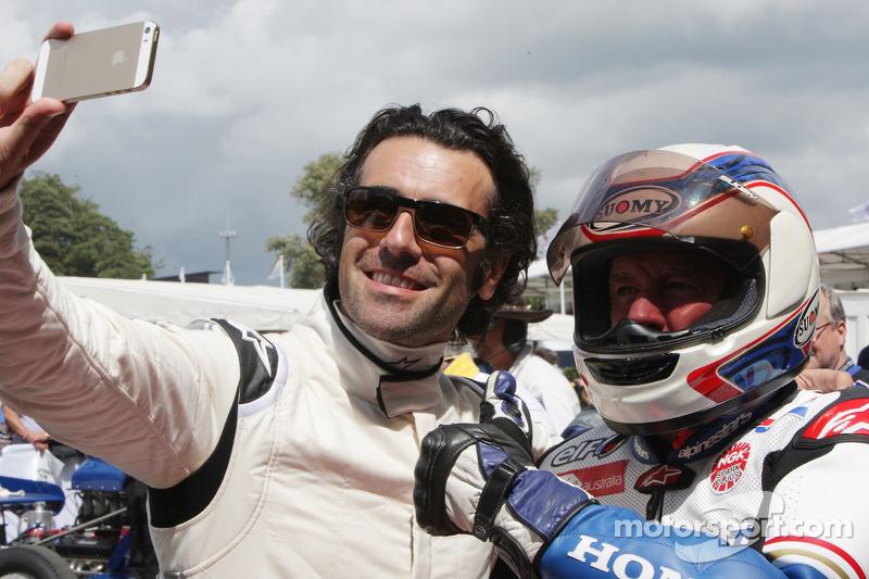 Dario Franchitti takes a selfie with Wayne Gardner