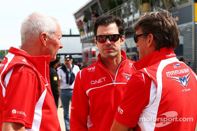 John Booth, Marussia F1 Team, Team Principal con Marc Hynes, Marussia F1 Team Dr. Vijay Malyaiver Coach e Graeme Lowdon, Amministratore Delegato Marussia F1 Team