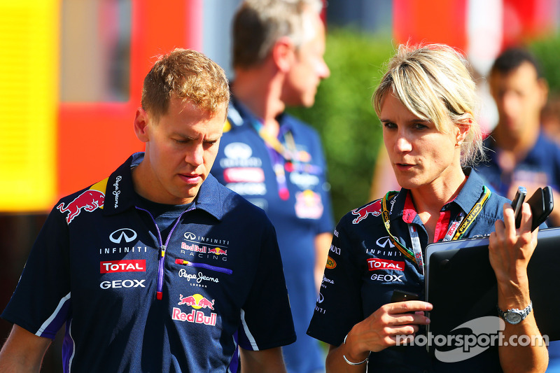 (L to R): Sebastian Vettel, Red Bull Racing with Britta Roeske, Red Bull Racing Press Officer