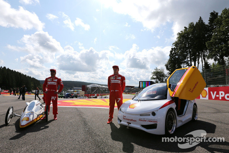 Fernando Alonso, Scuderia Ferrari and Kimi Raikkonen, Scuderia Ferrari drives a car from the Shell Eco Marathon