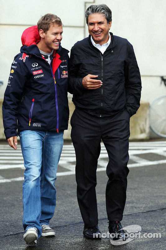 (L to R): Sebastian Vettel, Red Bull Racing with Pasquale Lattuneddu, of the FOM
