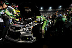 Crews work on the car of Dale Earnhardt Jr., Hendrick Motorsports Chevrolet