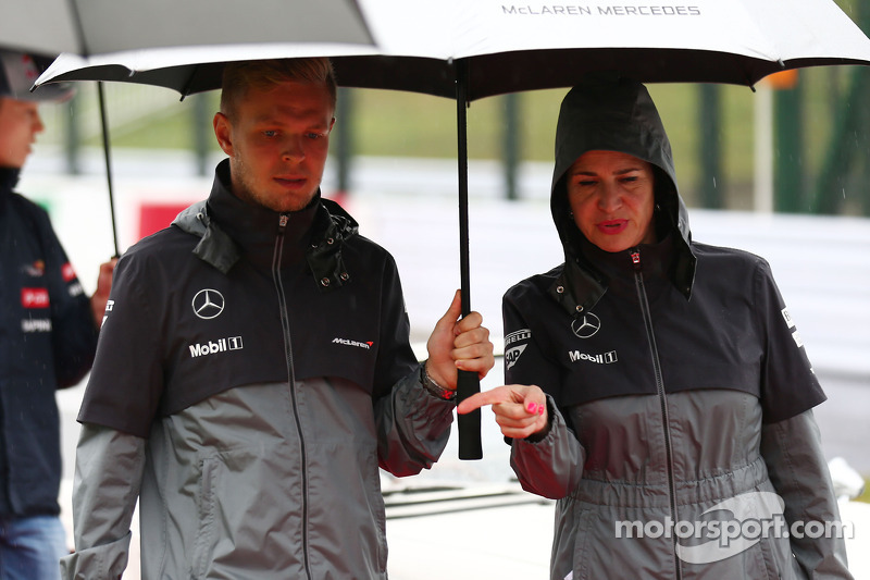 (L to R): Kevin Magnussen, McLaren and Silvia Hoffer, McLaren Press Officer, on the drivers parade