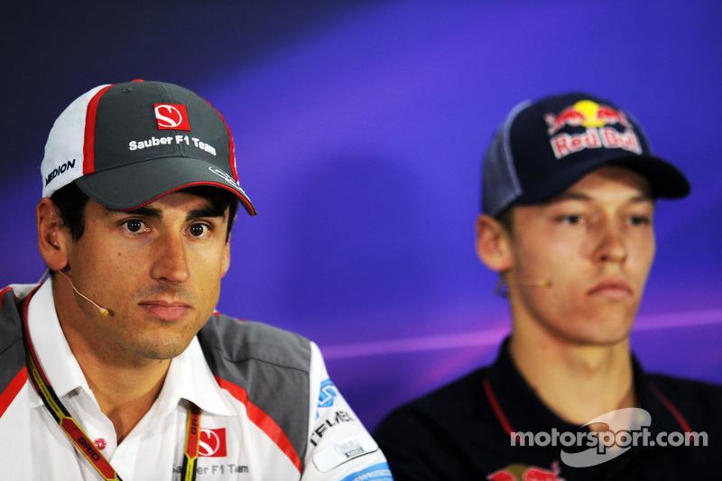 (L to R): Adrian Sutil, Sauber and Daniil Kvyat, Scuderia Toro Rosso in the FIA Press Conference